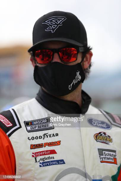 Corey LaJoie driver of the Storm Tight Windows Ford stands on the grid prior to the NASCAR Cup Series Dixie Vodka 400 at HomesteadMiami Speedway on...