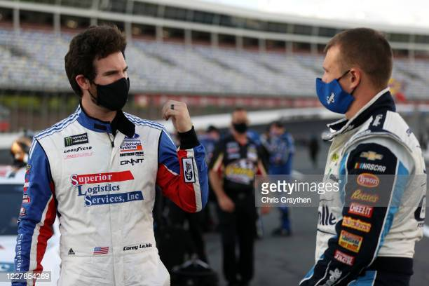 Corey LaJoie driver of the Superior Logistics Ford and Ryan Preece driver of the Cottonelle Chevrolet talk on the grid prior to the NASCAR Cup Series...