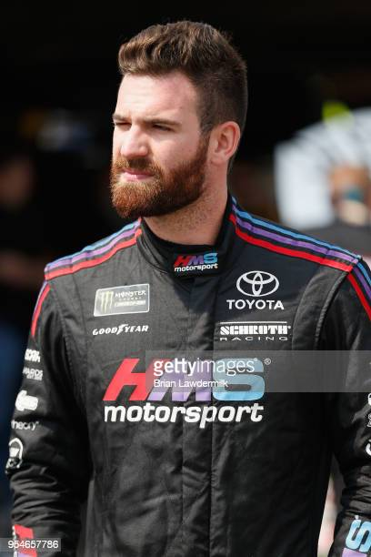 Corey LaJoie driver of the TriStar Motorsports Chevrolet walks to his car during practice for the Monster Energy NASCAR Cup Series AAA 400 at Dover...