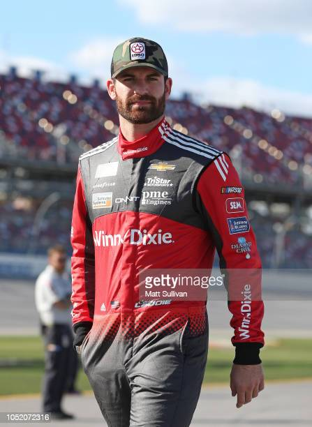 Corey LaJoie driver of the Winn Dixie Chevrolet walks to his car during qualifying for the Monster Energy NASCAR Cup Series 1000Bulbscom 500 at...