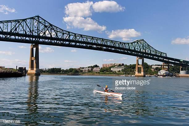 Corey Lancaster of Medford kayaks down the Mystic River into Boston Harbor