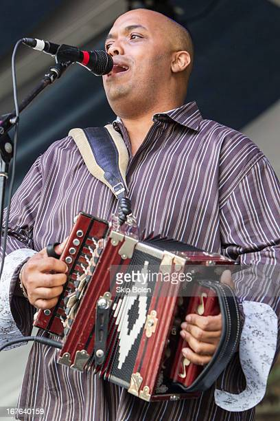 Corey Ledet of the Corey Ledet and his Zydeco Band performs during the 2013 New Orleans Jazz & Heritage Music Festival at Fair Grounds Race Course on...
