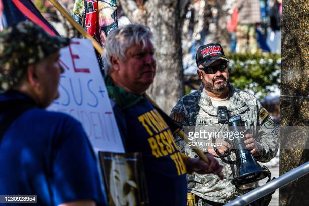 Corey Lequieu holds a megaphone during the demonstration. Protesters gathered at the state's legislative building to protest various causes such as...
