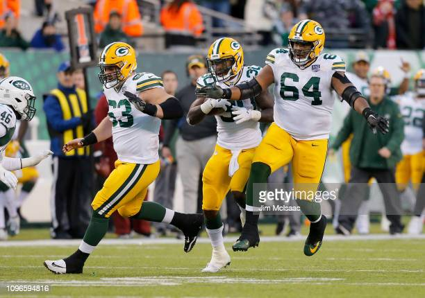 Corey Linsley, Jamaal Williams and Justin McCray of the Green Bay Packers in action against the New York Jets on December 23, 2018 at MetLife Stadium...