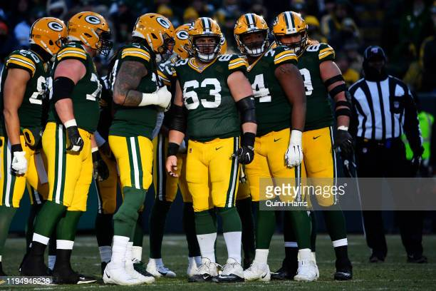 Corey Linsley of the Green Bay Packers and teammates looks on against the Chicago Bears at Lambeau Field on December 15, 2019 in Green Bay, Wisconsin.