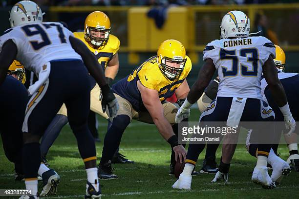 Corey Linsley of the Green Bay Packers gets into position for the snap in the second quarter against the San Diego Chargers at Lambeau Field on...