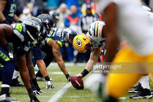 Corey Linsley of the Green Bay Packers prepares to snap the ball against the Seattle Seahawks during the 2015 NFC Championship game at CenturyLink...