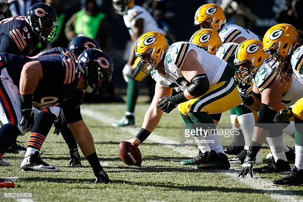 Corey Linsley of the Green Bay Packers prepares to snap the football in the first quarter against the Chicago Bears at Soldier Field on December 18,...