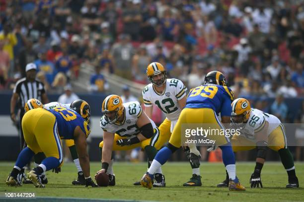 Corey Linsley of the Green Bay Packers snaps the ball to Aaron Rodgers of the Green Bay Packers while playing the Los Angeles Rams at Los Angeles...