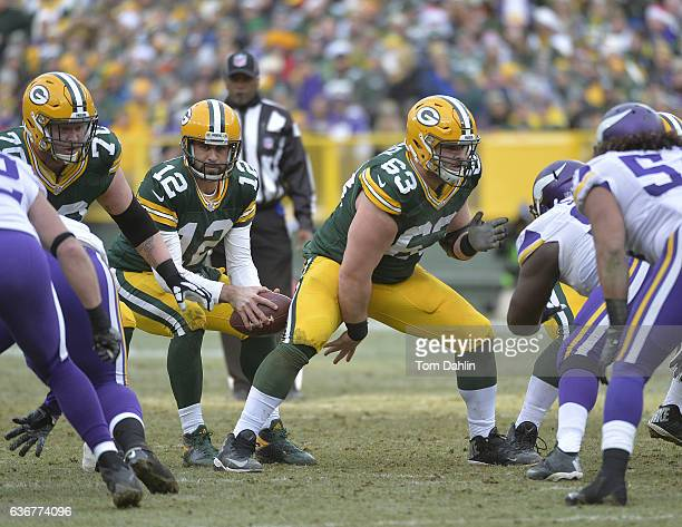 Corey Linsley of the Green Bay Packers snaps the ball to teammate Aaron Rodgers during a game against the Minnesota Vikings at Lambeau Field on...