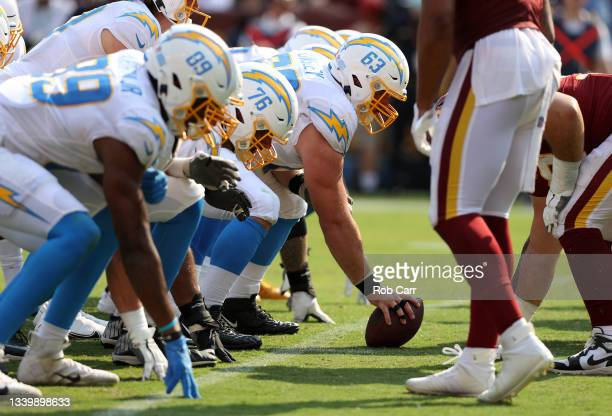 Corey Linsley of the Los Angeles Chargers prepares to snap the ball during the game against the Washington Football Team at FedExField on September...