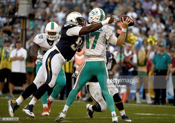 Corey Liuget of the San Diego Chargers hits Ryan Tannehill of the Miami Dolphins during the second half at Qualcomm Stadium on November 13 2016 in...