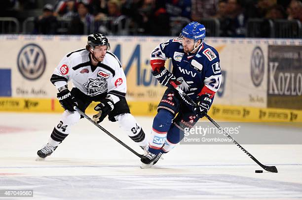 Corey Locke of Thomas Sabo Ice Tigers chases Robert Raymond of Adler Mannheim during the DEL Ice Hockey Playoffs Quarter Final Game 5 between Alder...