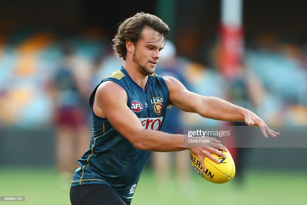 Corey Lyons kicks the ball during the Brisbane Lions AFL training session at The Gabba on May 17, 2018 in Brisbane, Australia.