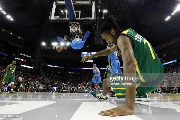 Corey Maggette of Power dunks after Josh Childress of Ball Hogs is blocked attempting a layup during week one of the BIG3 three on three basketball...