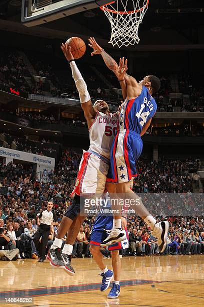 Corey Maggette of the Charlotte Bobcats charges against Gerald Green of the New Jersey Nets in pursuit of the basket during the game at the Time...