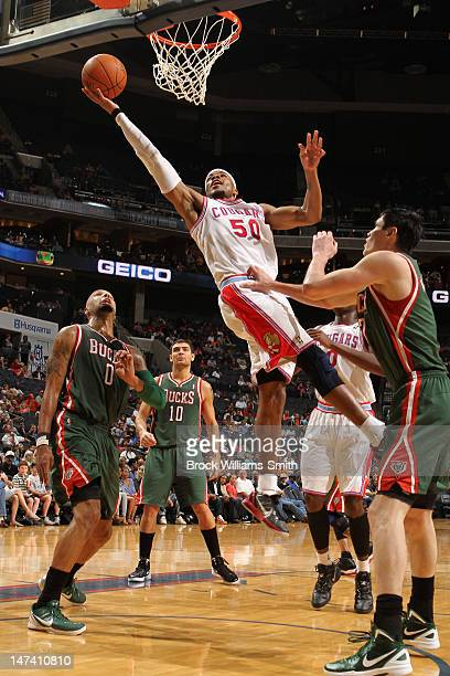Corey Maggette of the Charlotte Bobcats drives to the basket against the Milwaukee Bucks at the Time Warner Cable Arena on March 23 2012 in Charlotte...