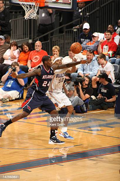 Corey Maggette of the Charlotte Bobcats grabs the pass against Marvin Williams of the Atlanta Hawks at the Time Warner Cable Arena on April 7 2012 in...