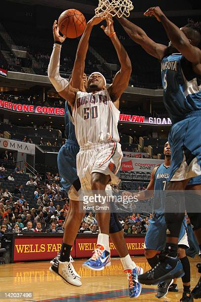 Corey Maggette of the Charlotte Bobcats shoots against Martell Webster of the Minnesota Timberwolves at the Time Warner Cable Arena on March 28 2012...