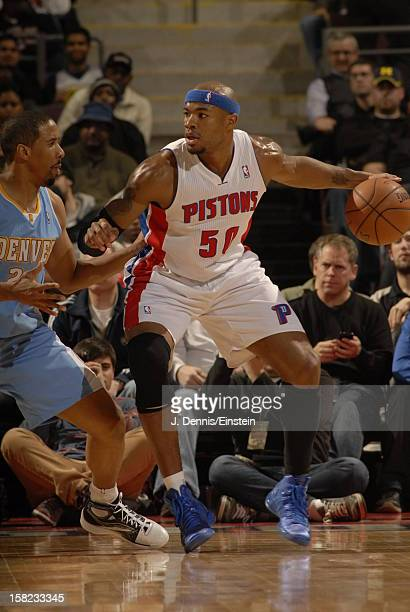 Corey Maggette of the Detroit Pistons dribbles the ball to the hoop against the Denver Nuggets during the game on December 11 2012 at The Palace of...