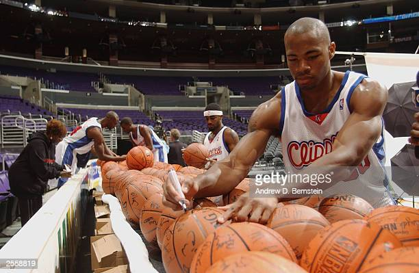Corey Maggette of the Los Angeles Clippers autographs basketballs during NBA Media Day at Staples Center on September 29 2003 in Los Angeles...