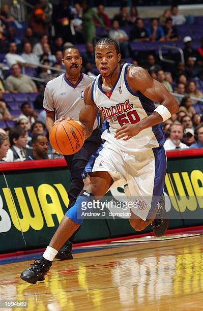 Corey Maggette of the Los Angeles Clippers drives to the basket during the game against the Memphis Grizzlies at Staples Center on October 13 2002 in...