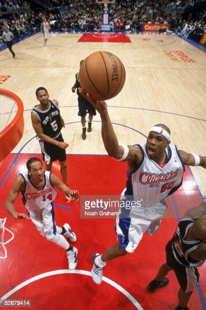 Corey Maggette of the Los Angeles Clippers goes up for a layup past Bruce Bowen of the San Antonio Spurs during a game at Staples Center on April 9...