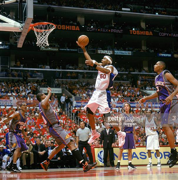 Corey Maggette of the Los Angeles Clippers reaches for the basket against Leandro Barbosa of the Phoenix Suns in game six of the Western Conference...