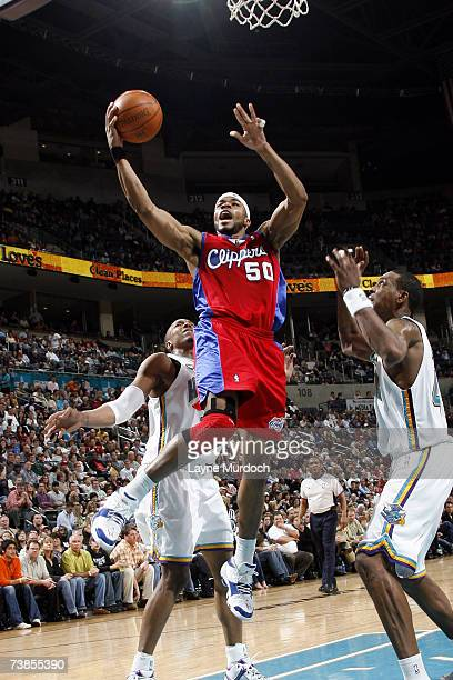 Corey Maggette of the Los Angeles Clippers shoots the ball against David West and Rasual Butler of the New Orleans/Oklahoma City Hornets at the Ford...