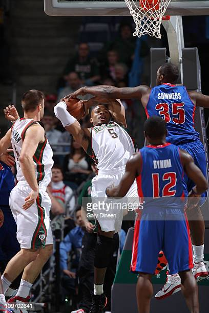 Corey Maggette of the Milwaukee Bucks draws a foul against DaJuan Summers of the Detroit Pistons during the NBA game on March 1 2011 at the Bradley...