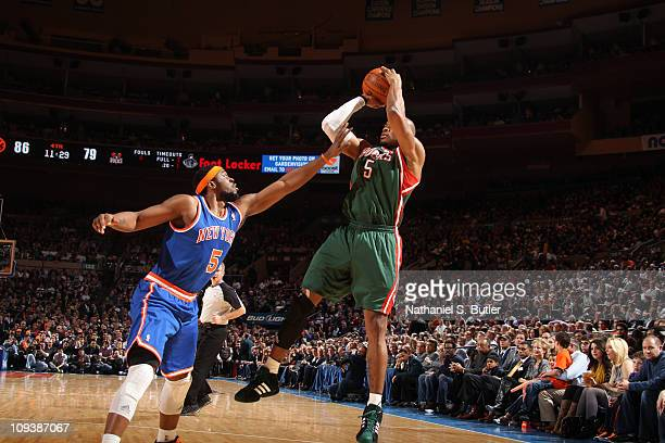Corey Maggette of the Milwaukee Bucks shoots against Bill Walker of the New York Knicks on February 23 2011 at Madison Square Garden in New York City...