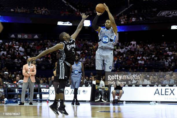 Corey Maggette of the Power attempts a shot while being guarded by Frank Robinson of the Enemies in the second half during week seven of the BIG3...