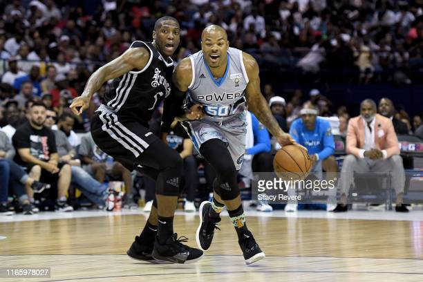 Corey Maggette of the Power dribbles the ball while being guarded by Frank Robinson of the Enemies in the first half during week seven of the BIG3...