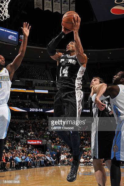 Corey Maggette of the San Antonio Spurs shoots against the Denver Nuggets on October 14 2013 at the Pepsi Center in Denver Colorado NOTE TO USER User...