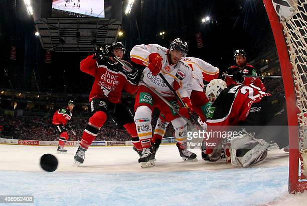 Corey Mapes of Duesseldorfer EG fails to score over Gustaf Wesslau during the DEL Ice Hockey match between Koelner Haie and Duesseldorfer EG at...