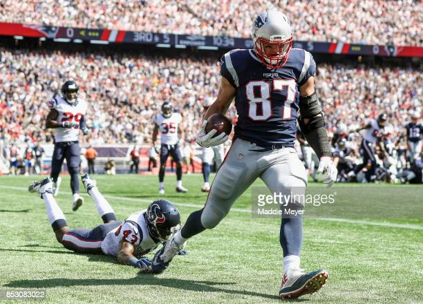 Corey Moore of the Houston Texans cannot defend Rob Gronkowski of the New England Patriots as he catches a touchdown pass during the second quarter...