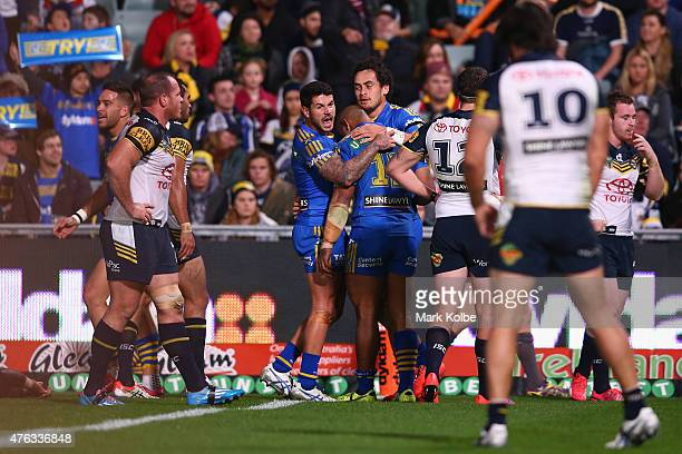 Corey Norman and Manu Ma'u of the Eels celebrate with Brad Takairangi of the Eels after he scored a try during the round 13 NRL match between the...