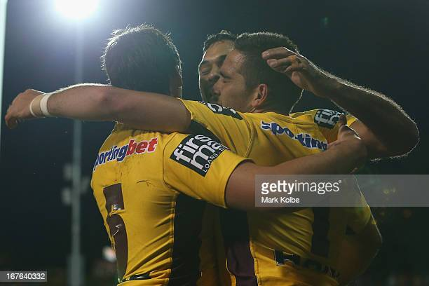 Corey Norman of the Broncos is congratulated by his team mates after scoring a try during the round seven NRL match between the Wests Tigers and the...