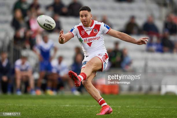 Corey Norman of the Dragons attempts to kick a field goal during the round 10 NRL match between the St George Illawarra Dragons and the Canterbury...