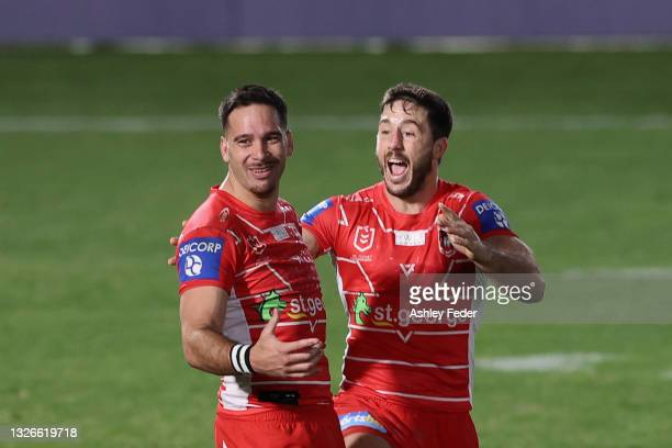 Corey Norman of the Dragons celebrates the win from his field goal with his team mates during the round 16 NRL match between New Zealand Warriors and...