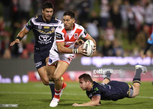 Corey Norman of the Dragons makes a break during the round 15 NRL match between the St George Illawarra Dragons and the North Queensland Cowboys at...