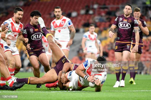 Corey Norman of the Dragons scores a try during the round 15 NRL match between the Brisbane Broncos and the St George Illawarra Dragons at Suncorp...
