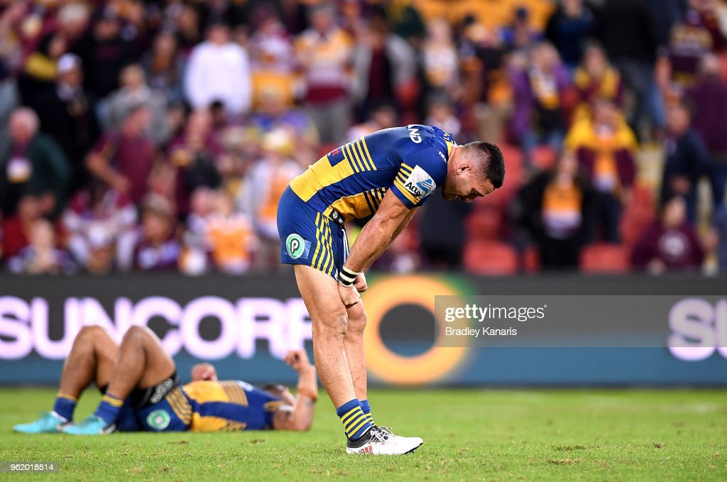 Corey Norman of the Eels and team mates look dejected after losing the round 12 NRL match between the Brisbane Broncos and the Parramatta Eels at Suncorp Stadium on May 24, 2018 in Brisbane, Australia.