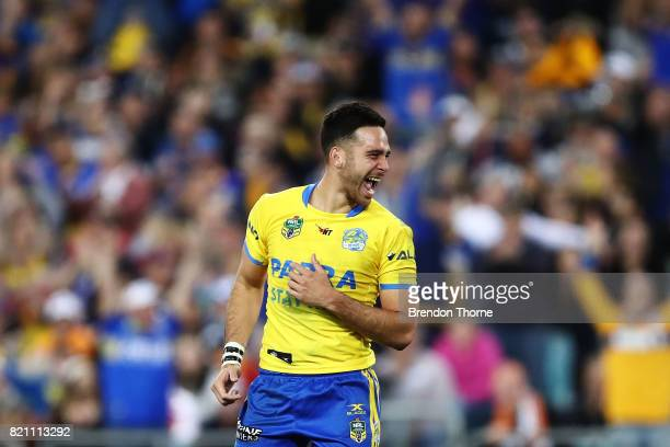 Corey Norman of the Eels celebrates kicking the winning field goal during the round 20 NRL match between the Wests Tigers and the Parramatta Eels at...
