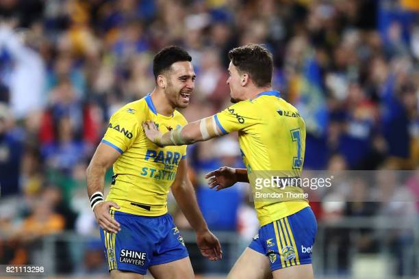 Corey Norman of the Eels celebrates kicking the winning field goal with team mate Clint Gutherson of the Eels during the round 20 NRL match between...