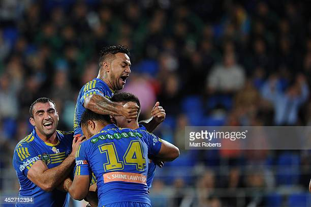 Corey Norman of the Eels celebrates scoring a try with team mates during the round 20 NRL match between the Gold Coast Titans and the Parramatta Eels...