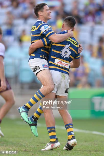Corey Norman of the Eels celebrates scoring a try with team mates during the round seven NRL match between the Parramatta Eels and the Manly Sea...