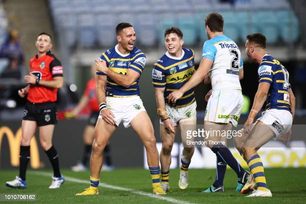 Corey Norman of the Eels celebrates with team mates after scoring a try during the round 21 NRL match between the Parramatta Eels and the Gold Coast...