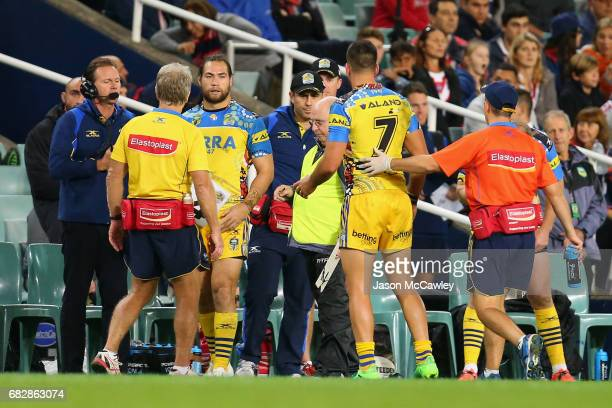 Corey Norman of the Eels is assisted from the field injured during the round 10 NRL match between the Sydney Roosters and the Parramatta Eels at...