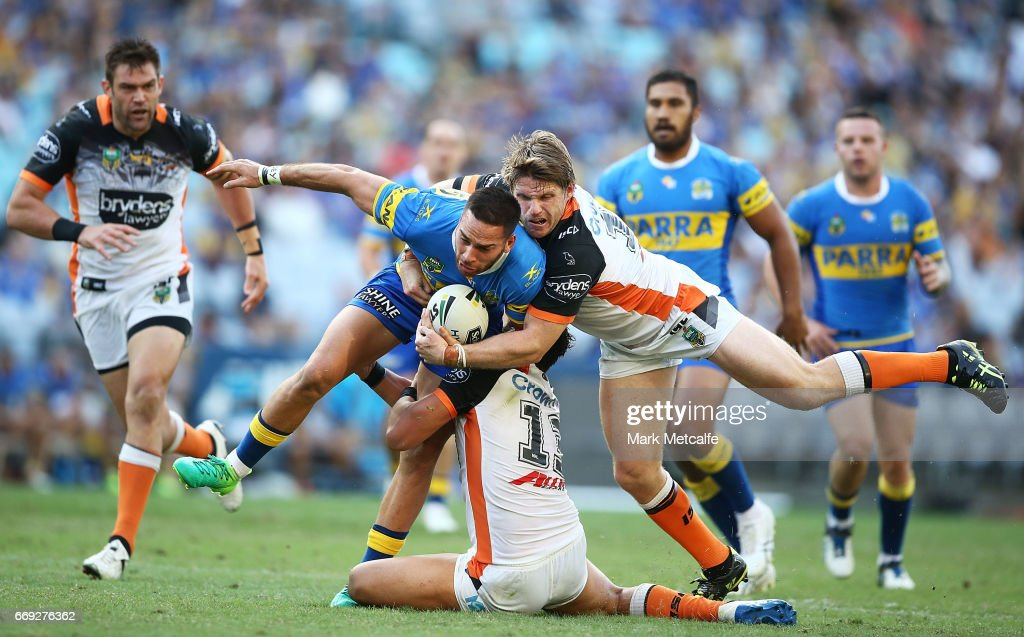 Corey Norman of the Eels is tackled by Chris Lawrence of the Tigers during the round seven NRL match between the Parramatta Eels and the Wests Tigers at ANZ Stadium on April 17, 2017 in Sydney, Australia.